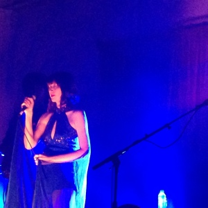 Karen O onstage with an enviable sparkly playsuit with built in cape...yes i want one!